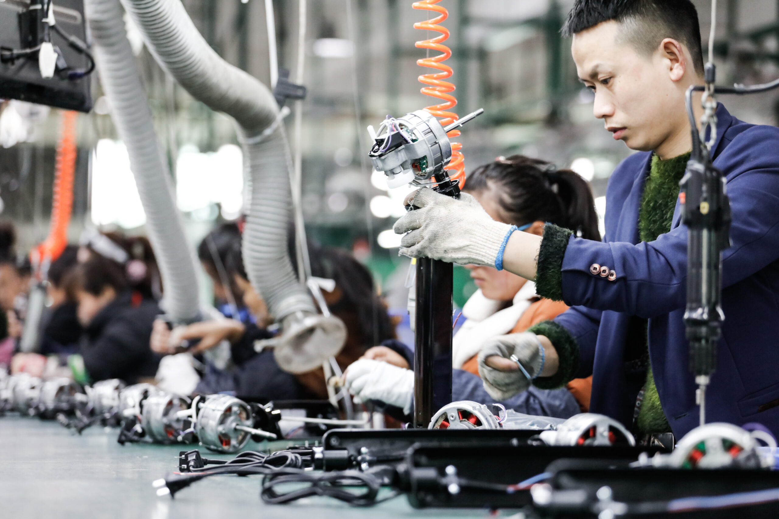 Jiujiang,China-march,17,,2018:,Workers,On,The,Production,Line,Of